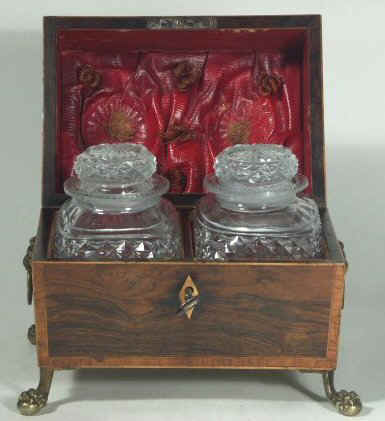 A Rare Rosewood Tea chest with twin cut crystal canisters Circa 1810. Please Click on image to enlarge