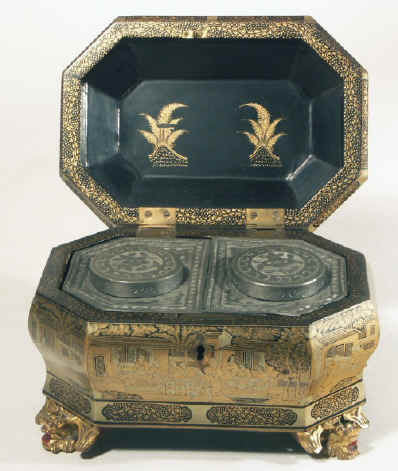 Chinese export lacquer tea chest with scenes of tea trading the interior fitted with metal canisters, circa 1840. chtealac06.jpg (143417 bytes)