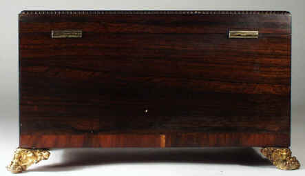 regneo05.jpg (71668 bytes) A Regency Neoclassical Rosewood Tea Chest with Brass inlay Circa 1810.