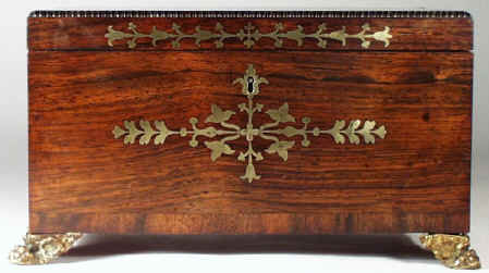 regneo07.jpg (83375 bytes) A Regency Neoclassical Rosewood Tea Chest with Brass inlay Circa 1810.