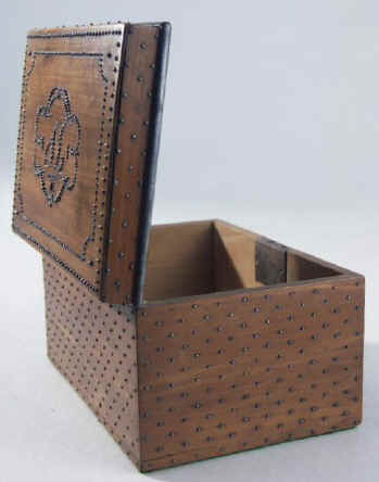 A continental pearwood tea caddy decorated with cut steel 1820-1840. (c) Hygra.com