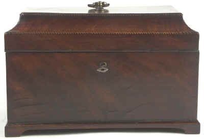 A flame mahogany tea chest of traditional Chippendale form with cavetto molding to the top and edged subtly with rope twist banding having brass edge escutcheon and Dutch drop handle and containing three tinned ferrous metal lift out containers. Circa 1775.  mahchcan03.jpg (19845 bytes)