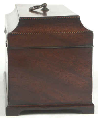 A flame mahogany tea chest of traditional Chippendale form with cavetto molding to the top and edged subtly with rope twist banding having brass edge escutcheon and Dutch drop handle and containing three tinned ferrous metal lift out containers. Circa 1775. mahchcan04.jpg (34754 bytes)