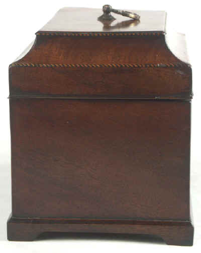 A flame mahogany tea chest of traditional Chippendale form with cavetto molding to the top and edged subtly with rope twist banding having brass edge escutcheon and Dutch drop handle and containing three tinned ferrous metal lift out containers. Circa 1775. mahchcan06.jpg (37457 bytes)
