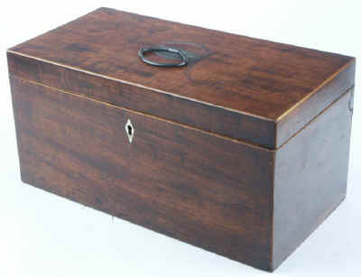 Hygra: Georgian mahogany three compartment tea chest having twin oval toped lift-out wooden canisters flanking a cut glass bowl. Circa 1790.