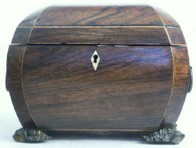 A bombe-shaped Regency  twin compartment tea caddy veneered in rosewood strung with boxwood with embossed feet and handles. Circa 1820.