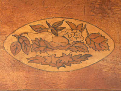 A three compartment inlaid  satin-birch tea caddy marquetry  depicting fruit  Circa 1795