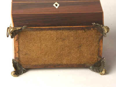 A  Regency shaped rosewood caddy with pyramided top with  brass  side handles�and feet Circa 1830