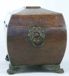 A burr yew  three compartment tea caddy/chest of bombe shape, pyramided top with gilded brass drop handles�handles and feet.