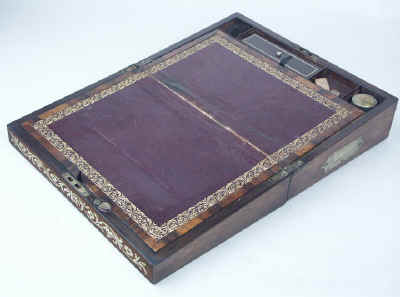 Hygra: beautifully grained wood contrasted with impeccable brass inlay: Regency Bulh(Boulle). wbrwbrstfl05.jpg (68696 bytes)