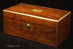 Writing box veneered in figured walnut, with rounded brass surround and brass lines. Strong Bramah lock. Enlarge Picture