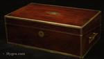 Regency brass edged mahogany writing box with secret drawers, by Thomas Lund of Cornhill, a replacement leather writing surface and compartments for pens and stationery. Circa  1820. The box retains its associated molded glass inkwells (period).