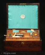 Antique flame mahogany sewing box with lift-out  compartmentalized tray fitted with silk winders and further spaces for thread reels. The tray is made from straight grained pine. The inside of the lid is lined with blue silk. There are brass escutcheons to the top and front. Circa 1830.