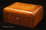 SB682: Antique inlaid figured walnut box with domed top opening to a ruched satin lined lid and a compartmentalized lift-out tray  fitted for sewing with supplementary lids Circa 1870.