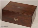 732SB: Early Victorian rosewood and mother of pearl inlaid box with a sewing tray covered in the original printed paper and blue silk, with compartments for threads and sewing tools, circa 1850.
