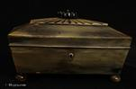 743SB: Anglo-Indian (Vizagapatam) box in wood covered in horn, of sarcophagus form, with a segmented radiating  top culminating in a turned and carved floral finial. An Indian interpretation of English Regency aesthetic. This is a small box which shows absolute mastery of design. Circa 1840.