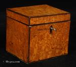 745TC:  Single compartment tea caddy veneered with bird's eye maple with a dark brown banding, the inside with a mahogany lid, Circa 1790.