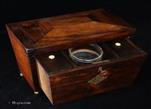 749TC: Rosewood veneered three compartment tea caddy of extraordinary form, opening like a drawer, circa 1850.
