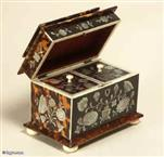 TC 113:  A particularly fine mother of pearl inlaid tortoiseshell two compartment tea caddy with pagoda top and molded base having ivory facings  standing on turned ivory feet  the inside  with supplementary lids which are also inlaid. Circa: 1825.