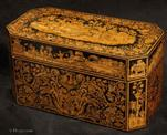 TC600: A very fine penwork tea chest, the penwork depicting scenes from the Silk Road. Inside there are two lift out tea canisters  and a cut glass Irish sugar bowl.