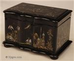 TC719: Papier mâché two compartment tea caddy  exquisitely decorated with oriental scenes in mother of pearl and gilding, the inside with supplementary lids.  The lock stamped with