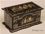 721TC-FR-hygra: Two compartment tea caddy decorated with Chinoiserie executed in inlaid mother of pearl.  On first sight this looks like papier mâché but it is in fact ebonised wood decorated in a manner which suggests papier mâché. The top is decorated with figures in a landscape with buildings. This exotic fantastical scene is  rooted in the Chinoiserie tradition, which reflected both the narratives and drawings brought back from the East by the first explorer/traders. One feature of the orient which captured the imagination of the Europeans was the extensive ornamental gardens complete with lakes and small islands, enjoyed by the cultural elite. Circa 1850.