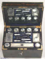 JB318: A very fine fully fitted figured coromandel dressing box by the Pittway Brothers  with engraved and gilded Bramah lock, stop hinges and accents and having a sprung drawer fitted for jewelry. Inside the box is fully fitted lined with leather and velvet and retains its cut crystal bottles and jars with hallmarked silver tops decorated with chassed repouss� work and engine turning. There is a lift out tray with further tray containing dressing accessories. There is a lift out reversible mirror and document wallet in the lid. Circa 1863. Enlarge Picture