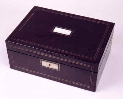 Antique  Fully Fitted Sewing  Box in Coromandel Ebony by Turrill of London,  circa 1840.  The interior is fully fitted with a lift out tray containing a set of turned and carved mother of pearl spools with bone screw on shafts. The box is of very good quality.