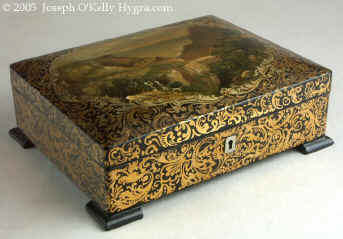 An artist painted Papier m�ch� sewing box having its original fully fitted tray with Dieppe turned and carved  spools and sewing tools Circa 1820.