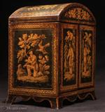 Rare Penwork table cabinet with curved Regency shape. The penwork depicts exquisite chinoiserie scenes of figures in the fantastical gardens of Cathay. The compartmentalized interior was fitted for jewelry in the 19th Century. The hinged doors open to four drawers with turned bone handles. The upper part was originally fitted for sewing. The divisions retain their original pink lining paper. The domed top and flared skirted base are unusual. A superb piece of its period. Circa 1820