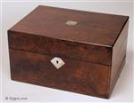 JB640:A richly figured burr walnut box with mother of pearl escutcheons with lift-out tray and sprung drawer fitted for jewelry. There is a lift-out gold embossed leather framed mirror in the lid with a document wallet behind. The box has a working lock and key Circa 1850.