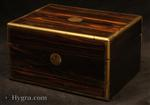 JB623: Antique brass edged figured coromandel box with sprung velvet lined drawer  and a lift out tray suitable for storing jewelry.   The box has small veneer repairs.. Working  lever lock and key. Circa: 1870