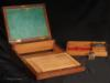 A mahogany brass bound box which is an example of  a combined dressing case and writing desk. The lift out dressing tray is fitted for holding a man's grooming accessories. This is a very unusual arrangement.  This box is very similar to another box on our site. The two must have come from the same workshop. Characteristic features of this box such as the particular shape of the protective corners, flat side handles, shape of central plaque, and quality of wood and workmanship, strongly point to the work of the cabinet maker Middleton who was recorded as working from 1801-10 at 162 Strand, London.