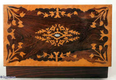 Antique writing box / lap desk, the top and front decorated with marquetry in contrasting rosewood and birds eye maple  depicting stylized themes from nature, opening down to reveal a green baize  velvet writing surface and compartments for pens and writing instruments. There are compartments for holding paper under the flaps. Circa 1840