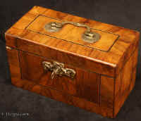 TC538: 18th century tea caddy veneered in figured walnut and having a brass carrying handle and escutcheon. Inside he caddy has one compartment which is lined with lead foil. However there is evidence that the caddy had three compartments previously. Circa 1770. Enlarge Picture