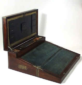 A triple opening rosewood veneered box, edged and strung in brass. The box combines strength, elegance, and impeccable workmanship in the Regency tradition.